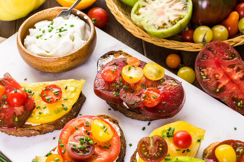 Heirloom Tomatoes. Tomato sandwich made with organic heirloom tomatoes royalty free stock photo
