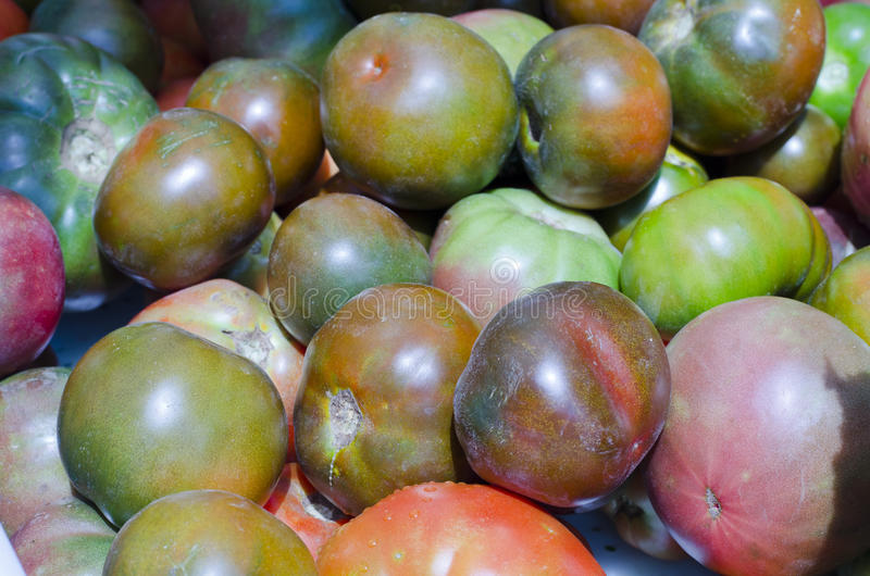 Heirloom Tomatoes. Varieties of heirloom tomatoes for sale in the market stock photo