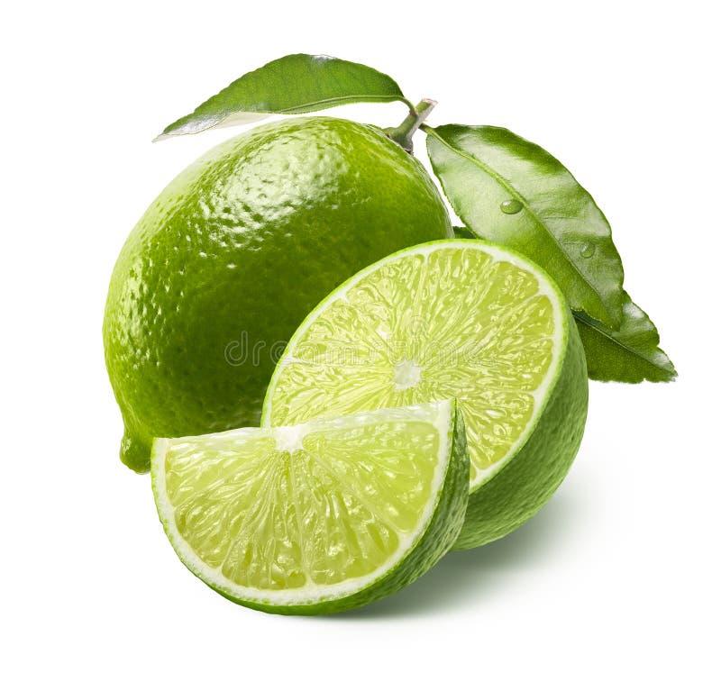 Hel halv och fjärdedelskiva för limefrukt som, isoleras på vit fotografering för bildbyråer