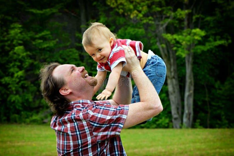 Download Held Aloft stock photo. Image of hand, childcare, papa - 31331014