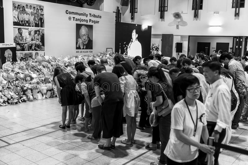 Held at one of the many community centres for public to pay last respect to late beloved Mr.Lee Kuan Yew. Group of public head bow to honour the remarkable man royalty free stock images