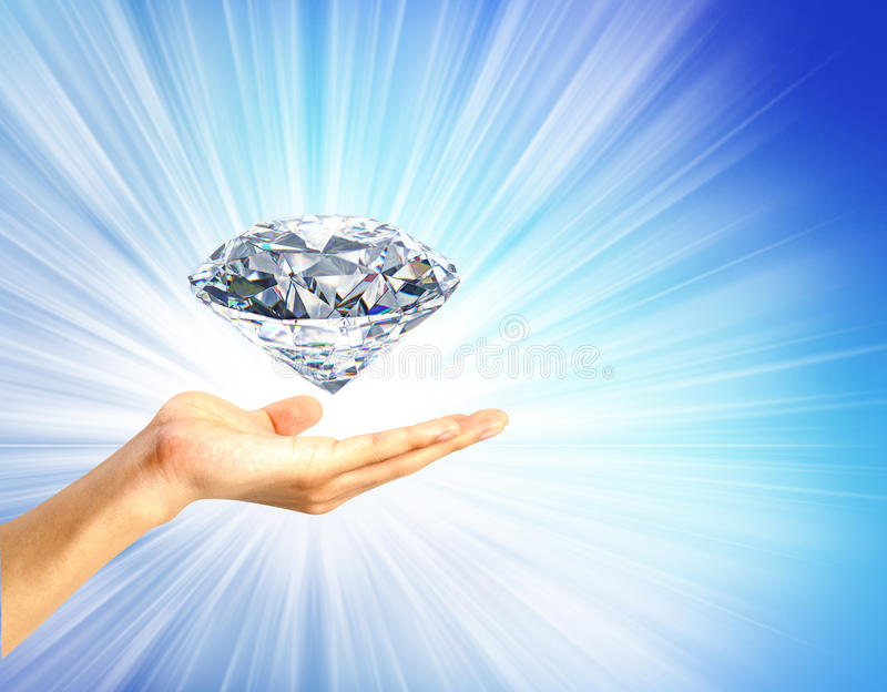 Helder beeld van hand met grote diamant stock foto's