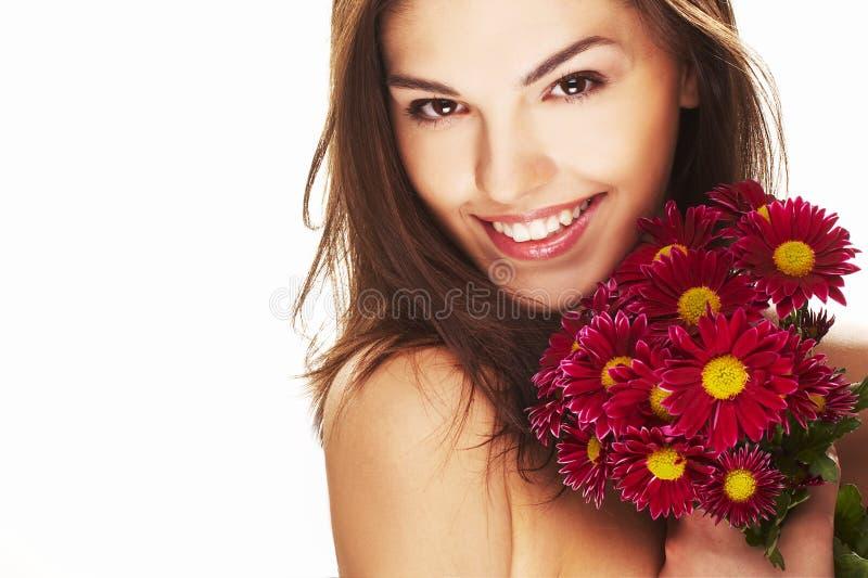 Helder beeld van mooi meisje met bloem royalty-vrije stock foto's