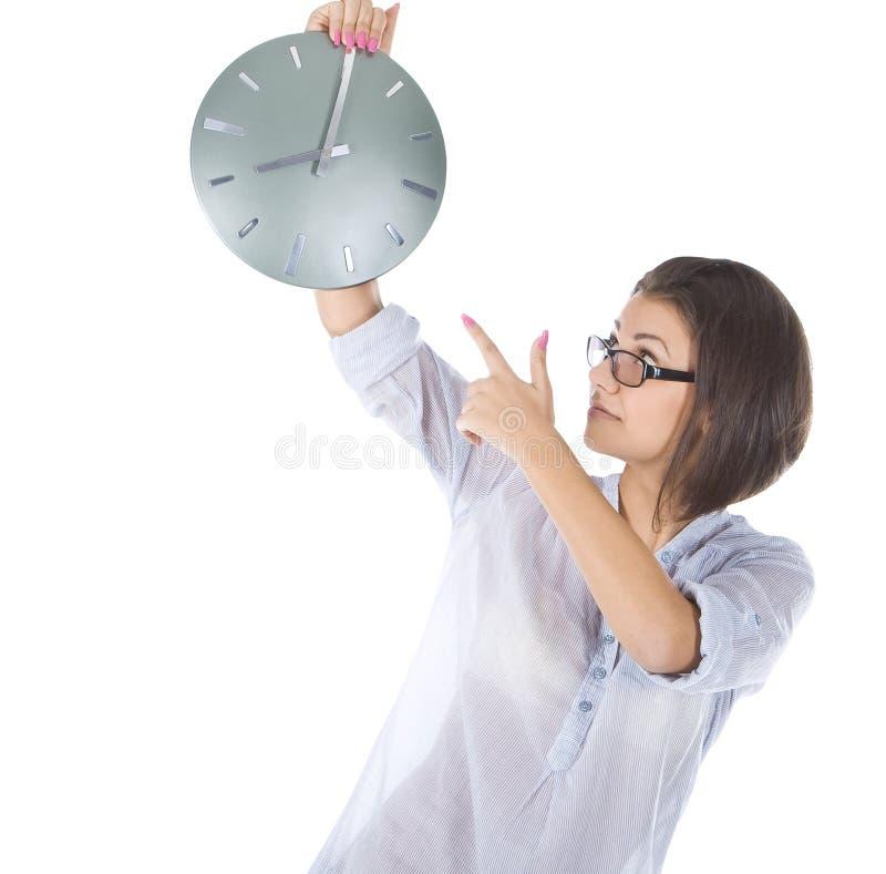 Helder beeld van onderneemster met grote klok stock afbeelding