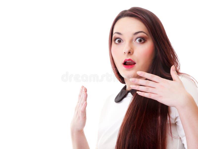 Helder beeld van verrast vrouwengezicht over wit stock afbeelding