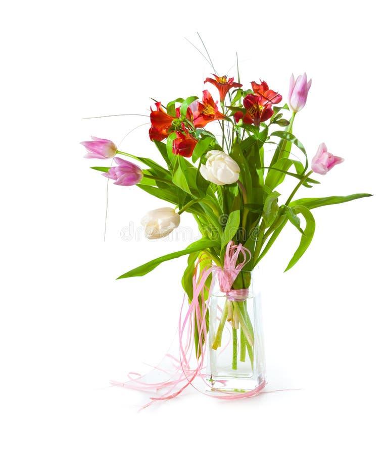 Helder bloemboeket in glas stock afbeeldingen