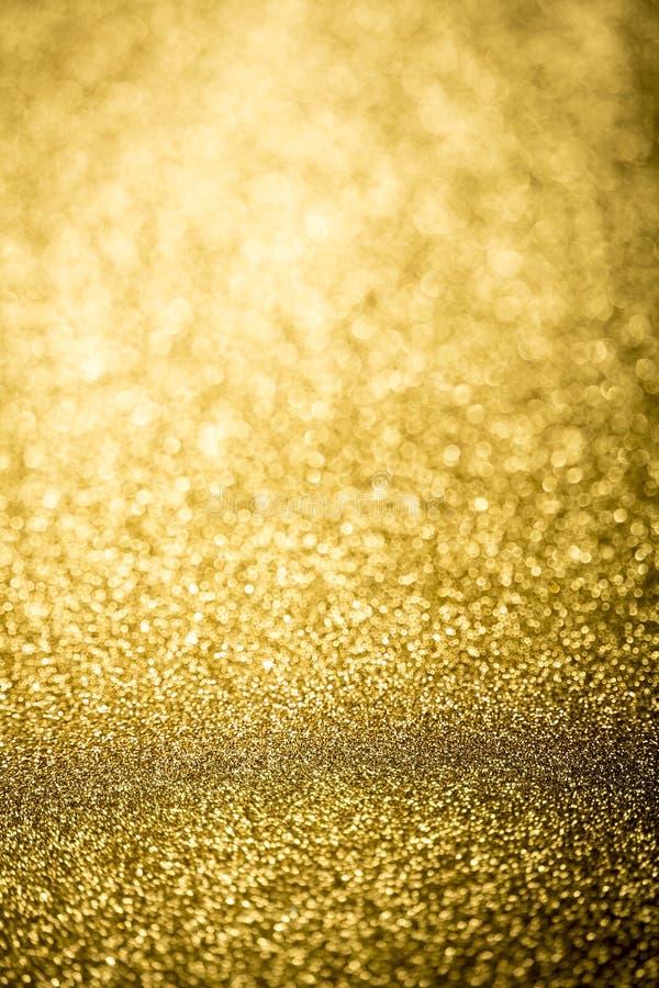Helder door achtergrond van nadruk de gouden abstracte bokeh stock afbeeldingen