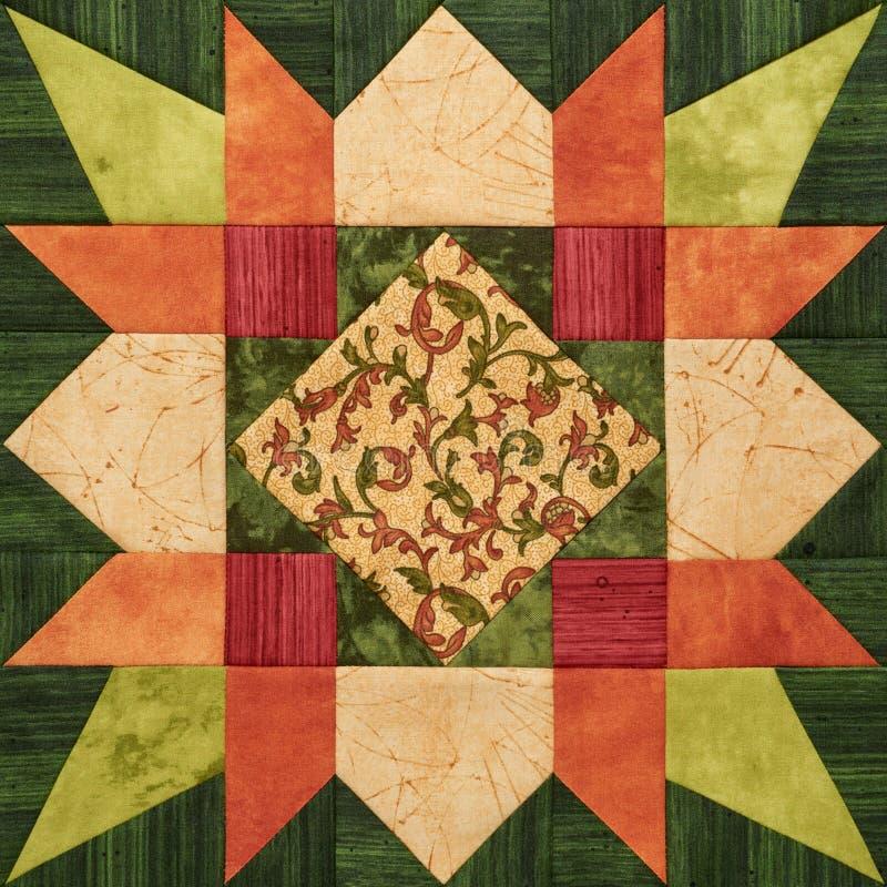 Helder oranje-groen geometrisch lapwerkblok van stukken van fab stock foto's