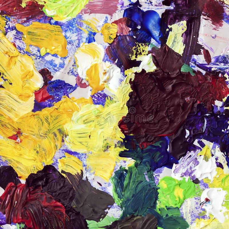 Helder palet van kunstenaar, textuur van gemengde olieverven in verschillende kleuren, mengelingsvlekken, vlekken, textuur voor m royalty-vrije stock foto
