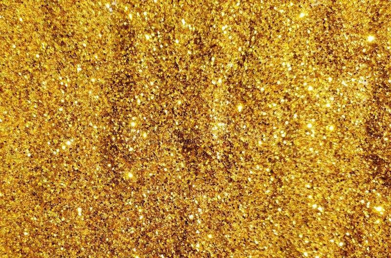 Heldere gouden schittert textuur voor viering en feestelijke ontwerpen stock fotografie