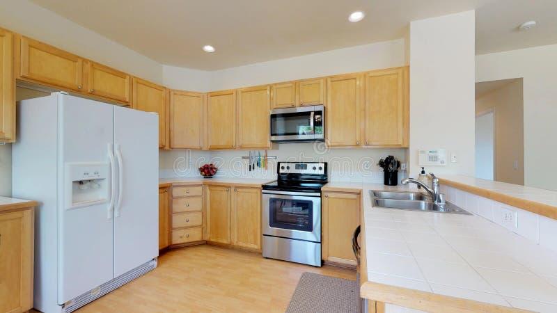 Heldere keukenruimte met lichte houten kabinetten royalty-vrije stock foto's