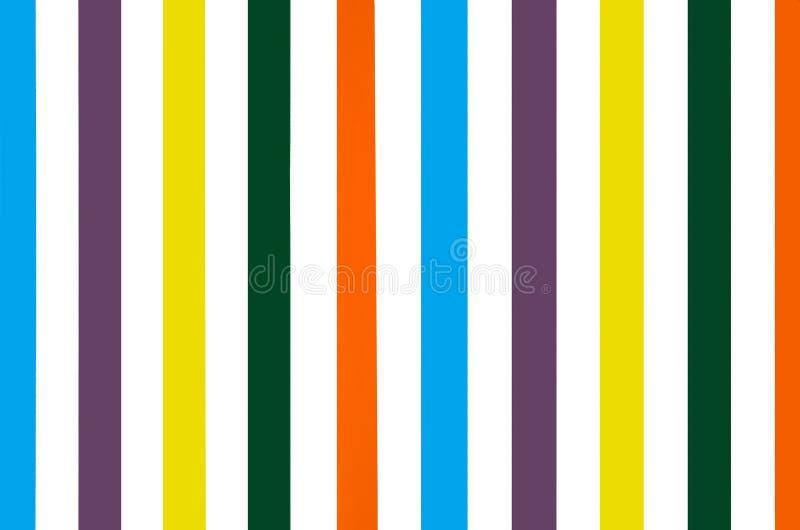 Heldere kleurrijke gestreepte muurachtergrond stock foto's