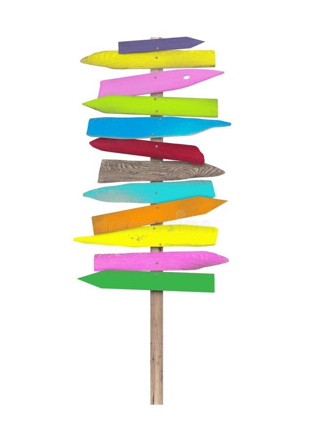 Heldere kleurrijke lege houten richtingstrandtekens op pool stock fotografie