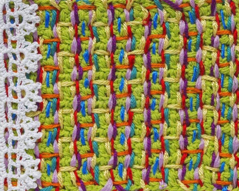 Heldere met de hand gemaakt haakt patroon, het breien, het naaien Eigengemaakte steek kleurrijke achtergrond, borduurwerk Achterg royalty-vrije stock fotografie