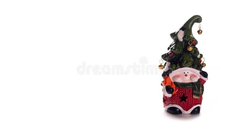 Heldere stuk speelgoed dwerg met een vrolijk gezicht en een klok op een hoed op een witte achtergrond Nieuw jaar, Kerstmisdecorat royalty-vrije stock afbeeldingen