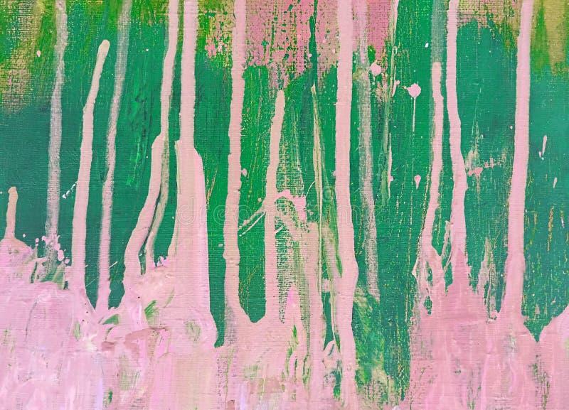 Heldere vlekken en vlekken van roze en groene verf op het canvas abstracte achtergrond stock foto's