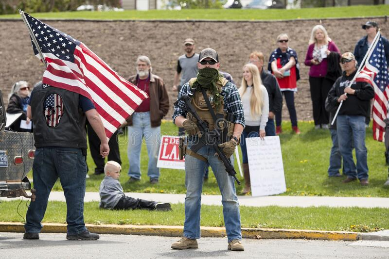 Helena, Montana - May 20, 2020: An armed man, militia member, protest at the Capitol building, holding a semi-automatic weapon in royalty free stock photo