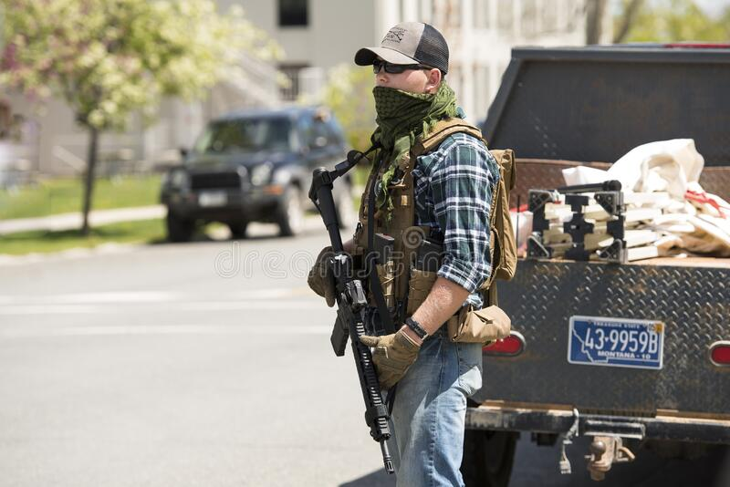 Helena, Montana - May 20, 2020: An armed man, militia member, protest at the Capitol building, holding a semi-automatic weapon in royalty free stock image