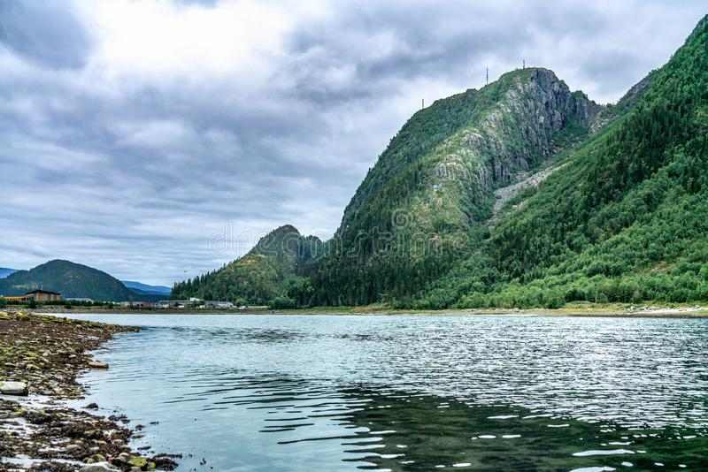 Helgelandstrappa - the path in the valley on the photo to mountains up in Mosjoen, town in Norway. The river`s name is Vefsna -. Gives the start to Vefsna fjord royalty free stock photography