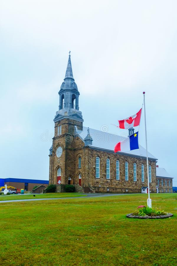 Helgon Peter Catholic Church, i Cheticamp royaltyfri fotografi