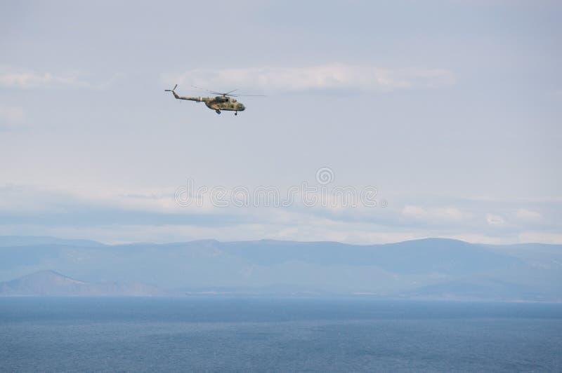 Download Helicóptero foto de stock. Imagem de povos, helicóptero - 65581394