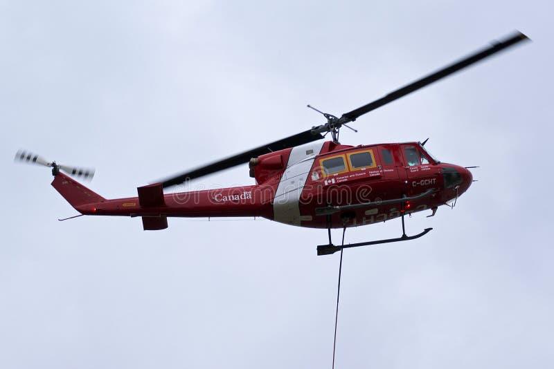 Helicóptero canadense de Bell 212 da guarda costeira - pesca e oceanos imagens de stock