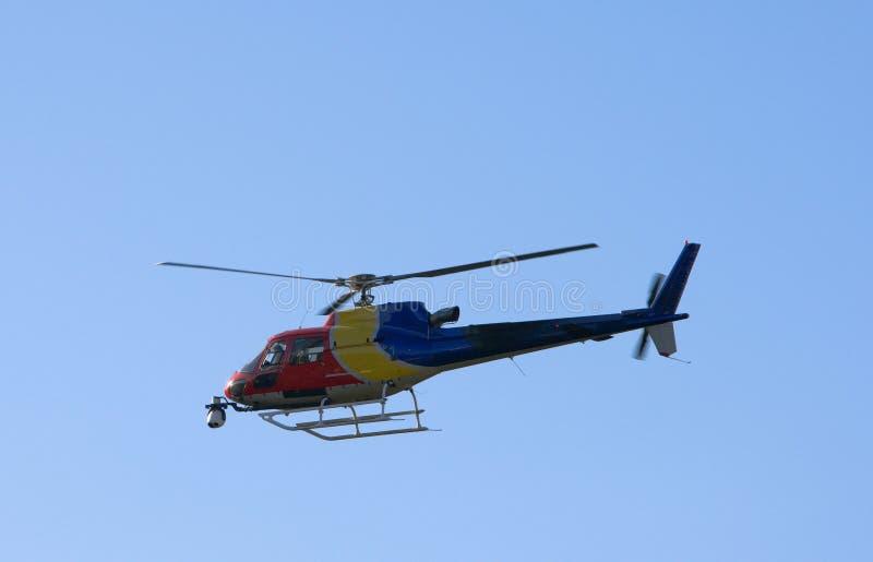 Helicóptero con la cámara imagen de archivo
