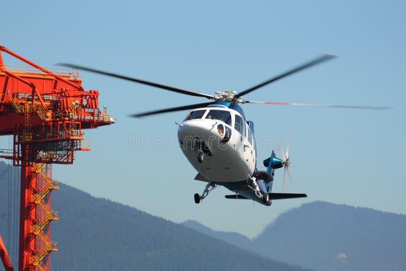 Helicóptero que chega, porto do viajante de bilhete mensal de Vancôver foto de stock