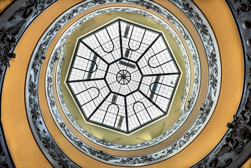 VATICAN CITY, VATICAN: Majestic spiral staircase of the Vatican museum. View from the bottom to up. Rome, Italy royalty free stock photography