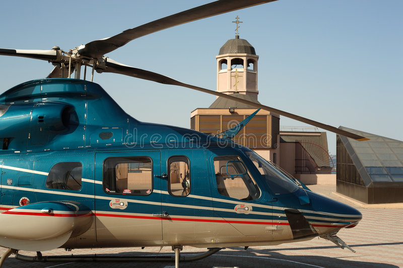 The helicopter, air transport,. The helicopter, near church. Air transport stock photos