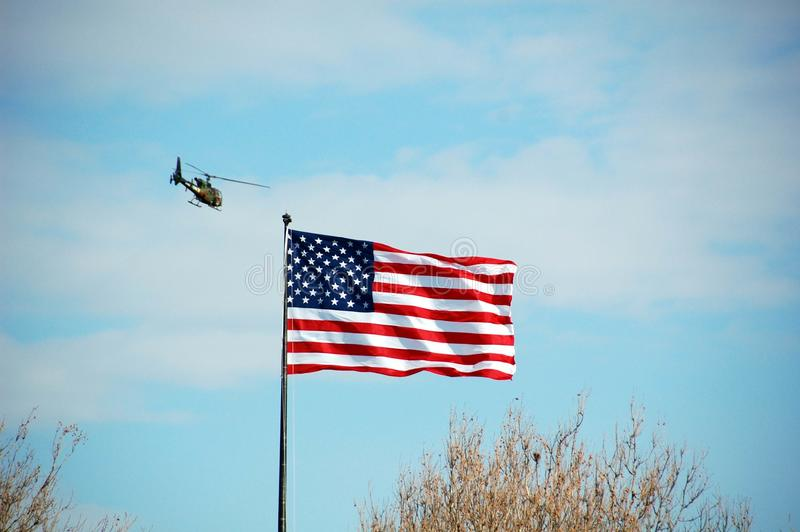 Helicopter and American Flag. Stars and Stripes / American Flag, with military helicopter in the background stock photography