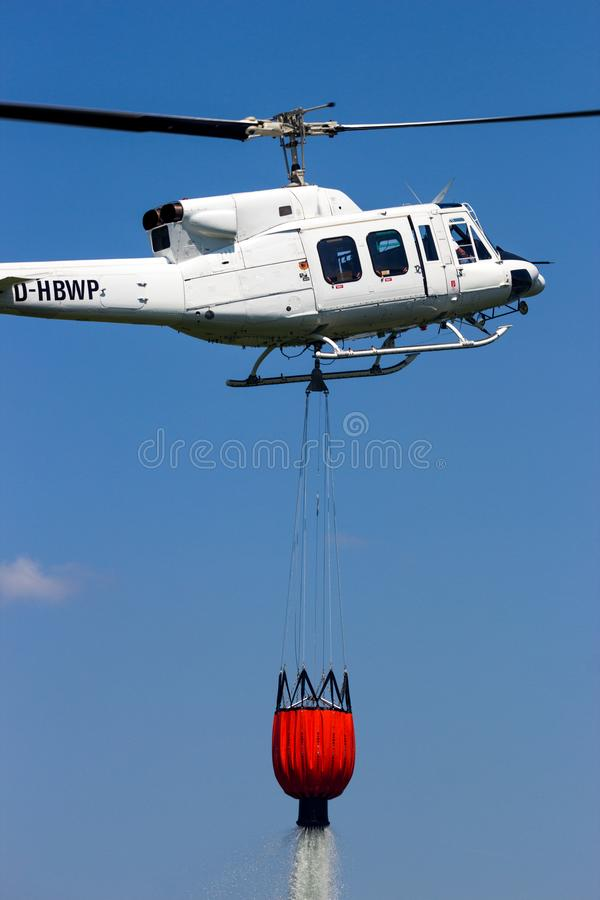 Helicopter bambi bucket aerial fire fighting stock photography
