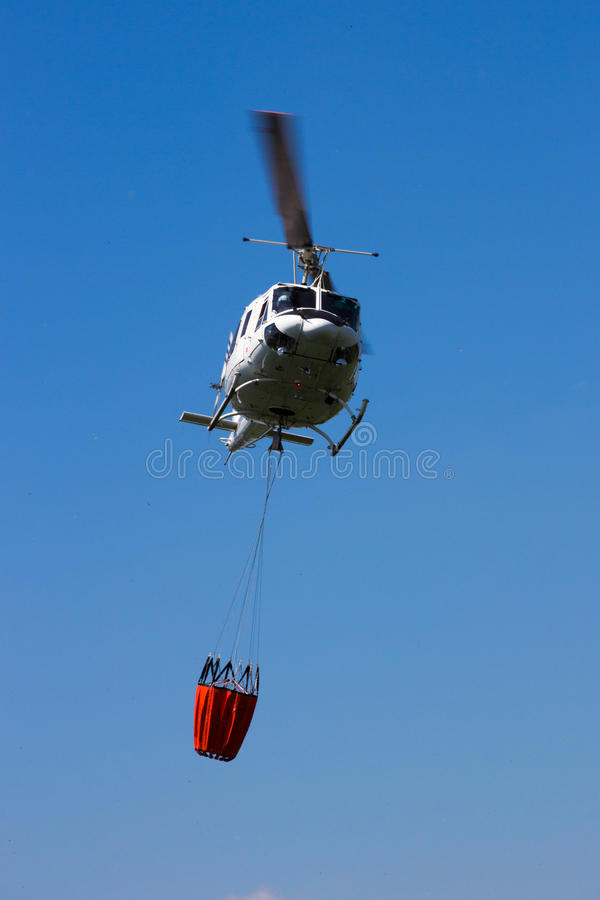 Helicopter aerial fire fighting stock photo