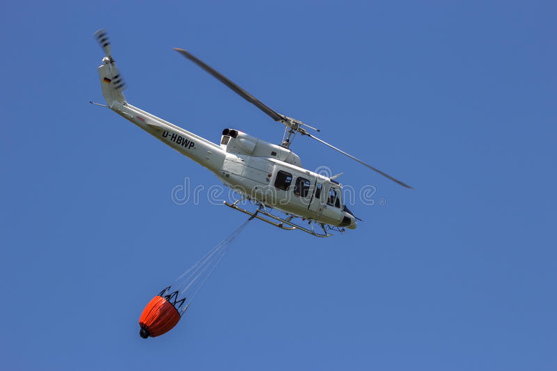 Helicopter bambi bucket fire fichting royalty free stock photo