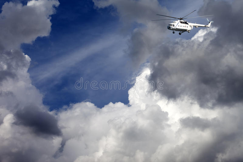 Helicopter in blue sky stock photography