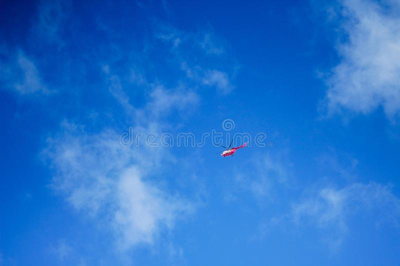 Helicopter in a blue sky.air transport.fly and speed. Helicopter in a blue sky.air transport stock photography