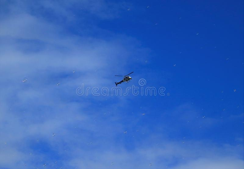 Helicopter and bubbles stock photography