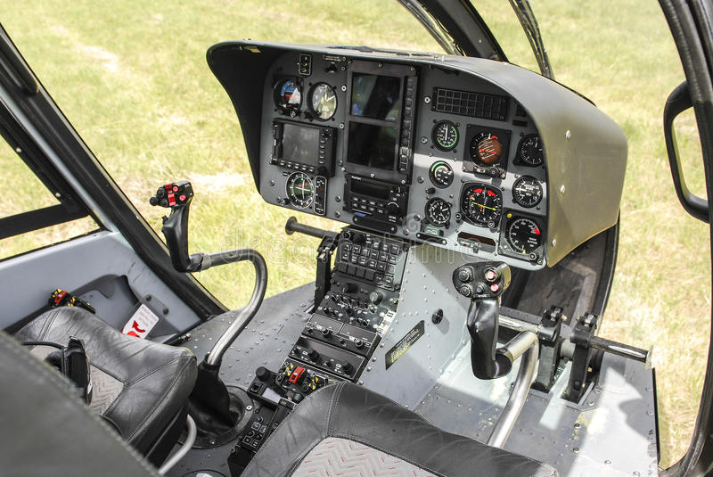 Helicopter cockpit. View at a helicopter cockpit royalty free stock image