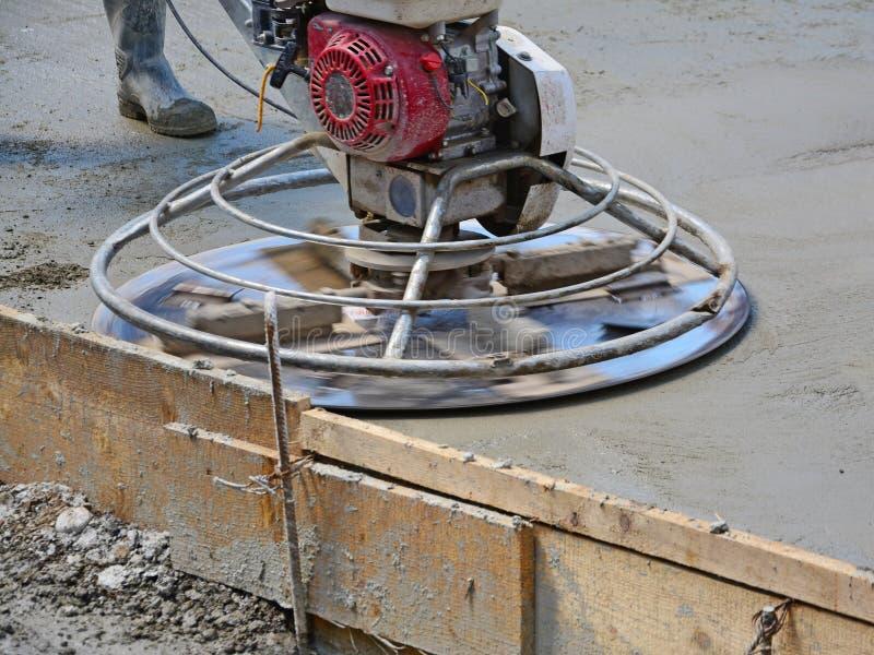 Elicottero Cemento : Helicopter concrete finishing stock photo image of road