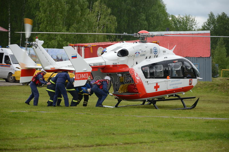 Helicopter emergency medical aid EU-145 on the range of Noginsk rescue center EMERCOM of Russia at the International Salon `Integr royalty free stock photography