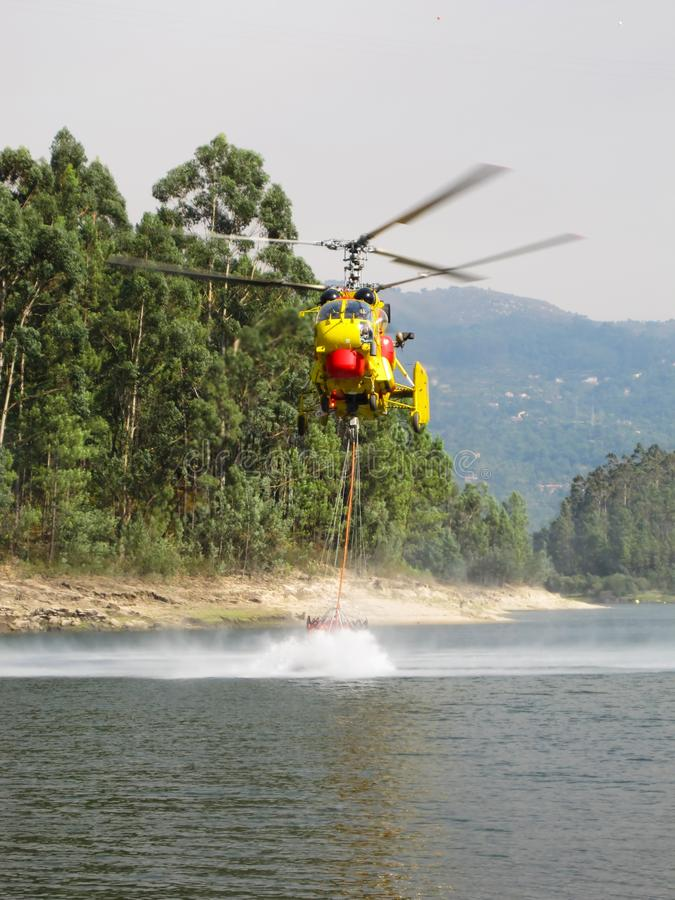 Helicopter fighting fire royalty free stock images