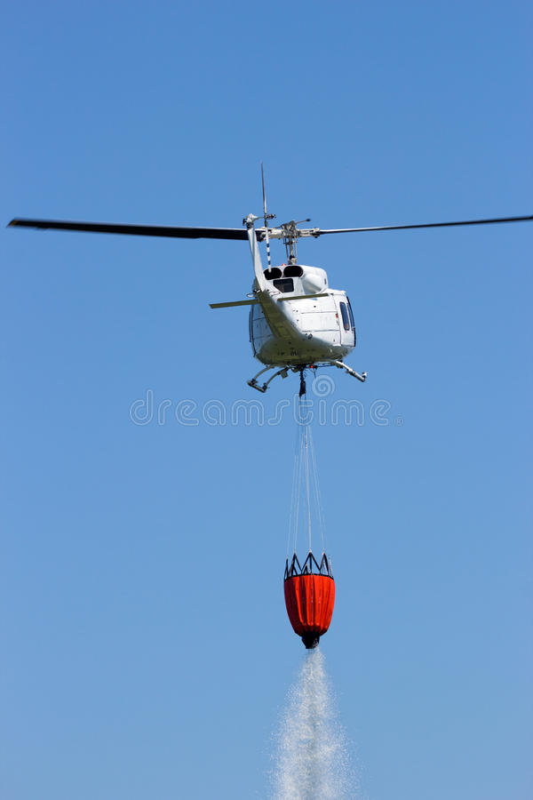 Helicopter fire fighting stock photo