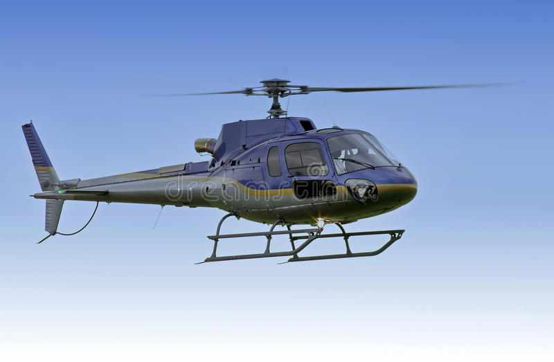 Helicopter flying on mission. On blue background royalty free stock photography