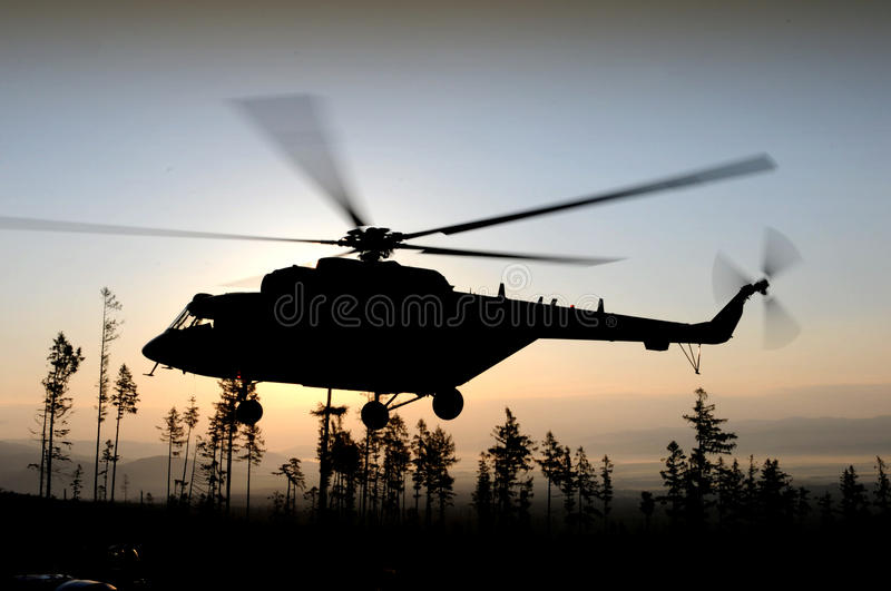 Helicopter flying at night stock image