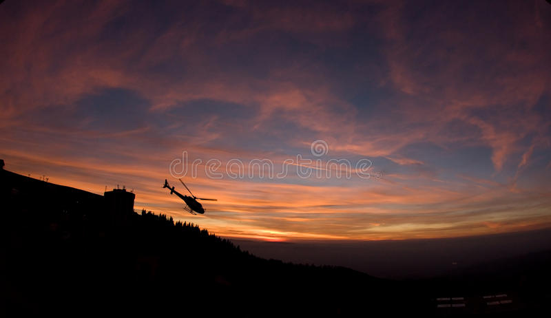 Helicopter Flying at Sunset stock image