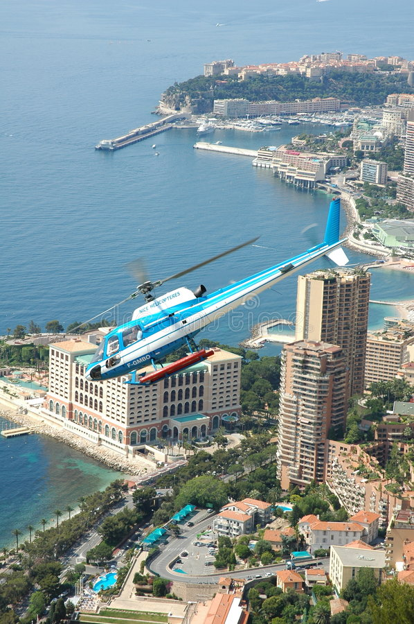 Helicopter in front of the skyline of Monaco stock photo