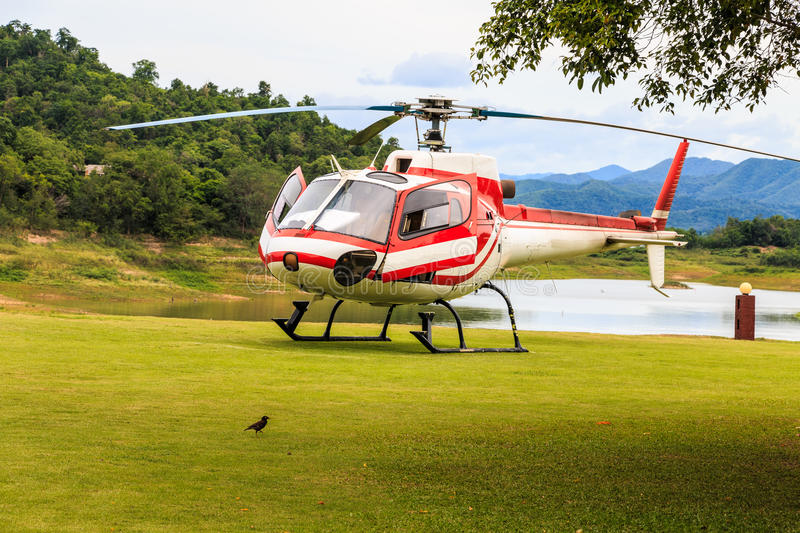 Helicopter on a green grass field stock photo