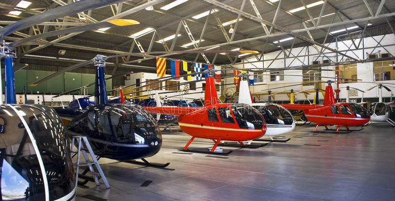 Helicopter Hangar, Full of Robinson R44 stock images