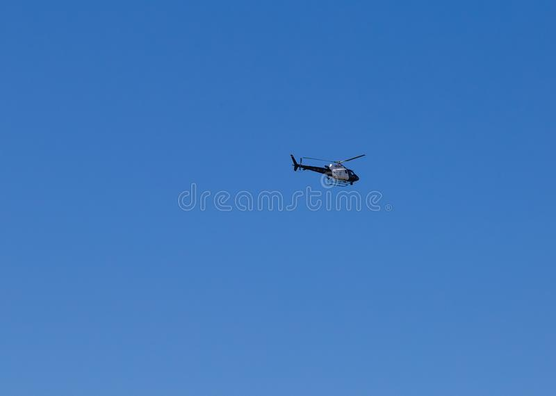 Helicopter hovering over Santa Monica Pier California royalty free stock image