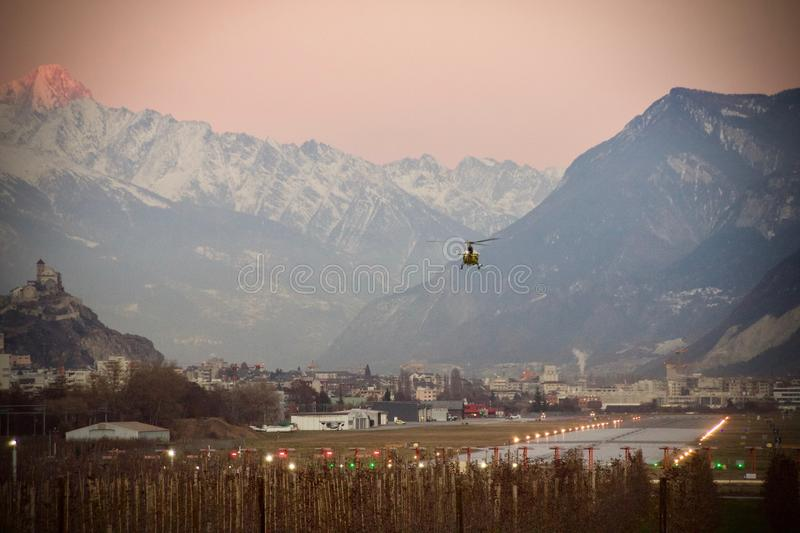 Helicopter at lander. In Sion royalty free stock photo